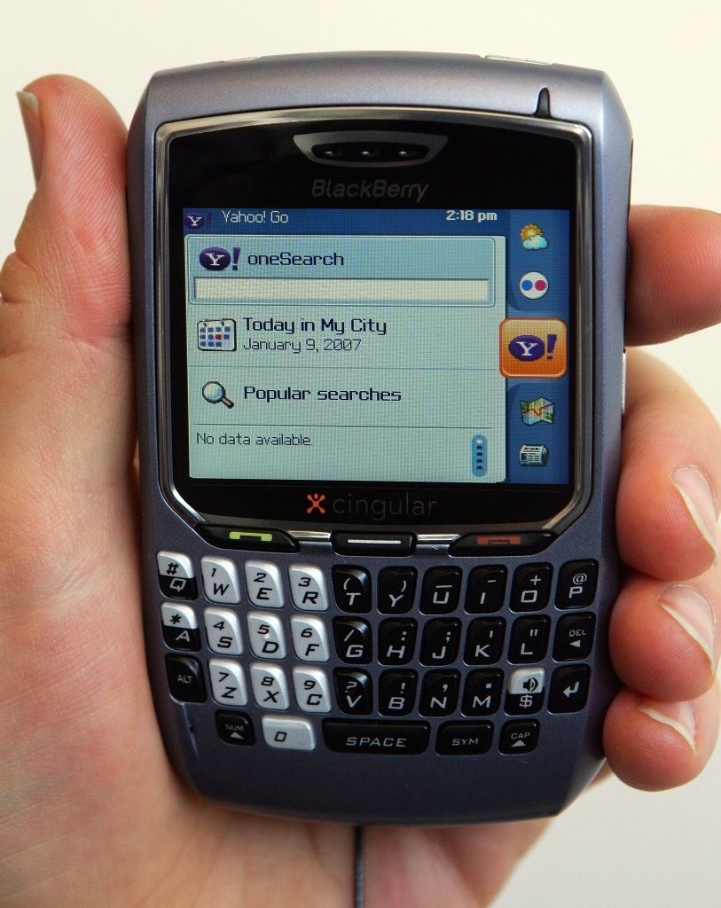 A photo of hand holding a BlackBerry