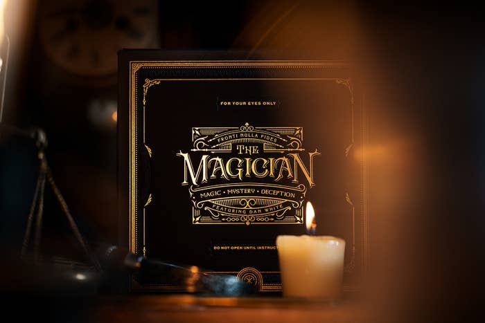 "A box with ornate type that reads ""For your eyes only; The Magician; Magic • Mystery • Deception; Featuring Dan White"""