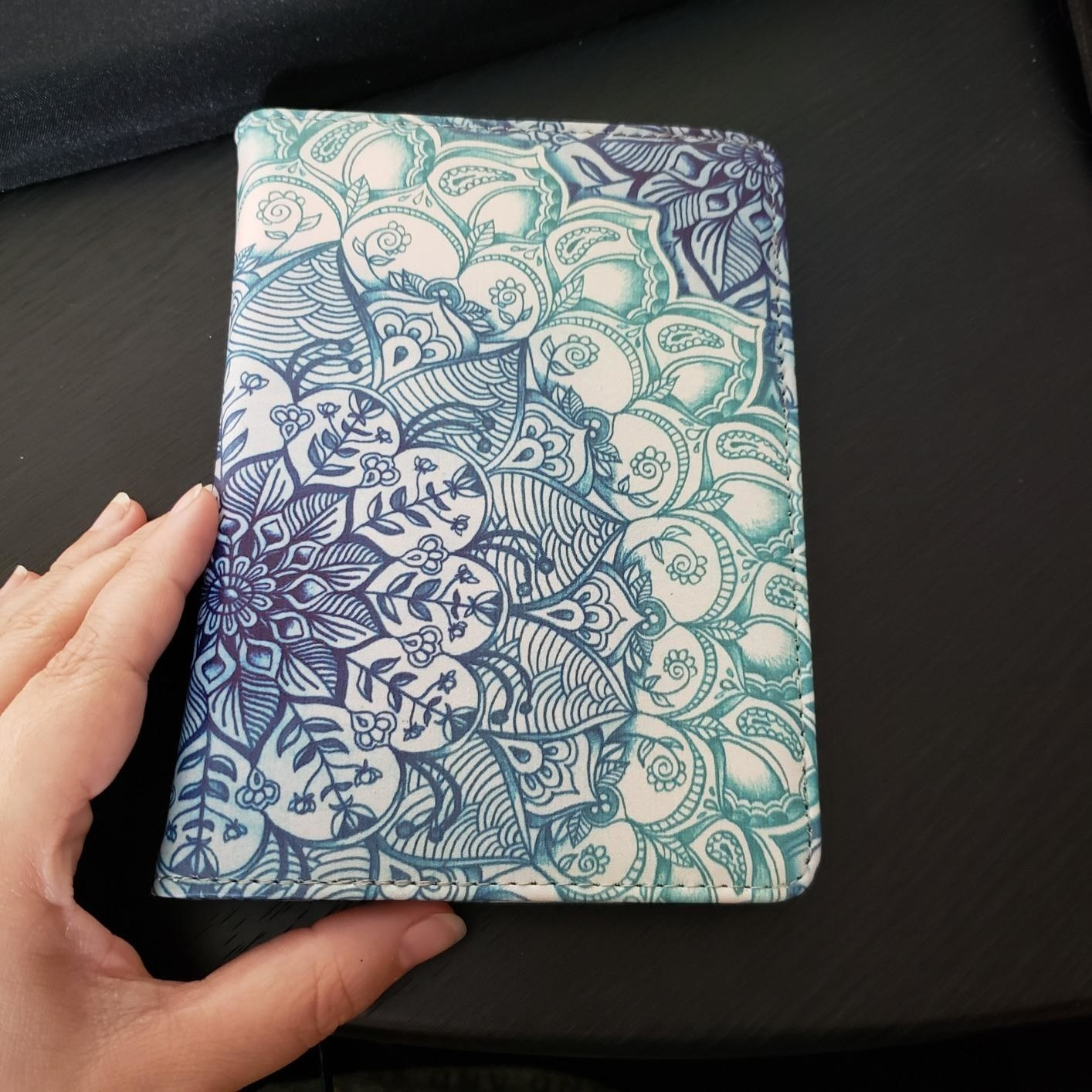 reviewer's kindle case with a blue and teal floral design