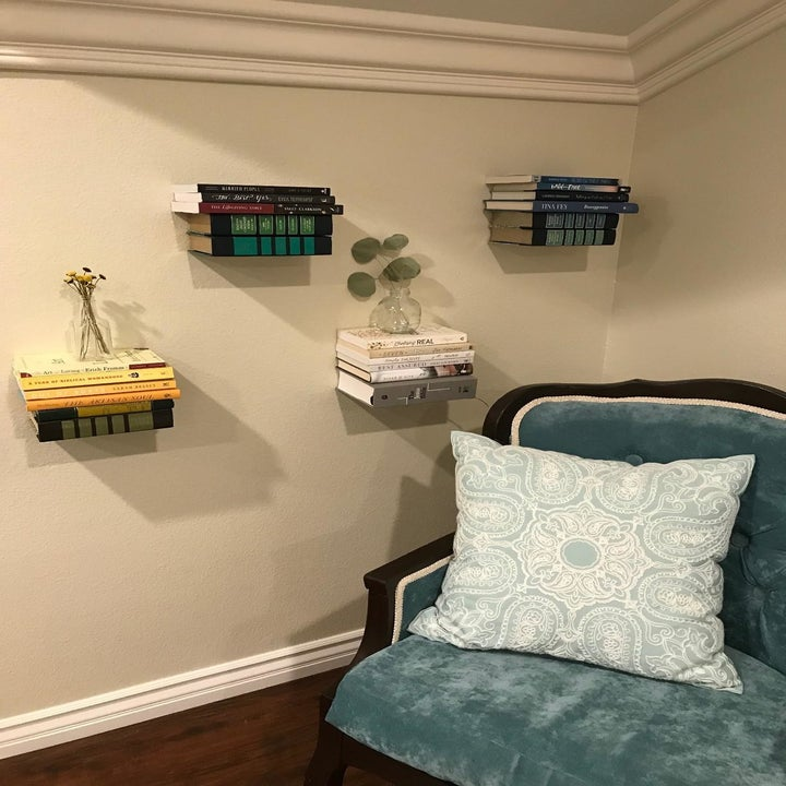 reviewer's floating bookshelves on a wall next to a chair