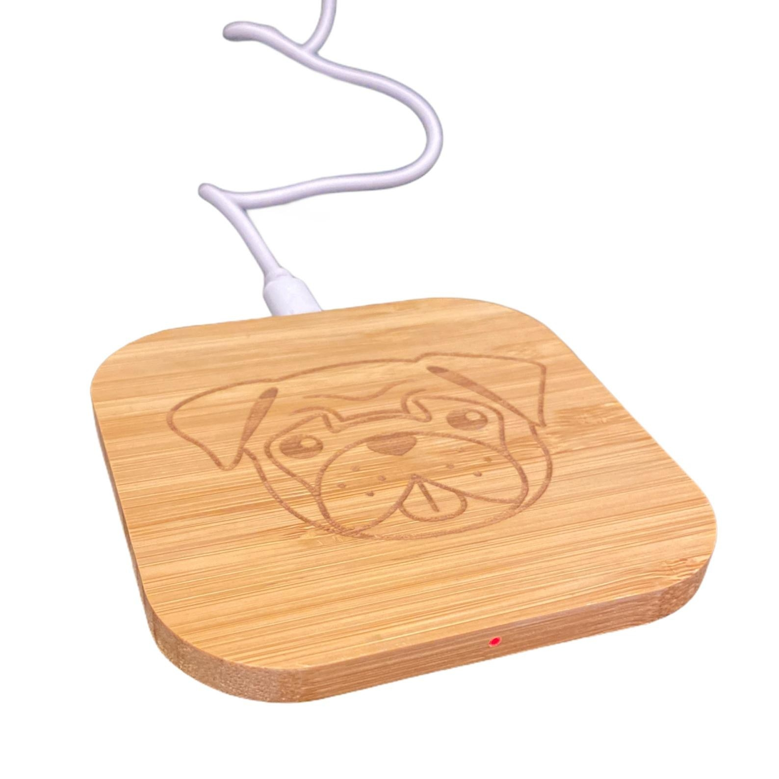 The bamboo charger with a pug face etched into it