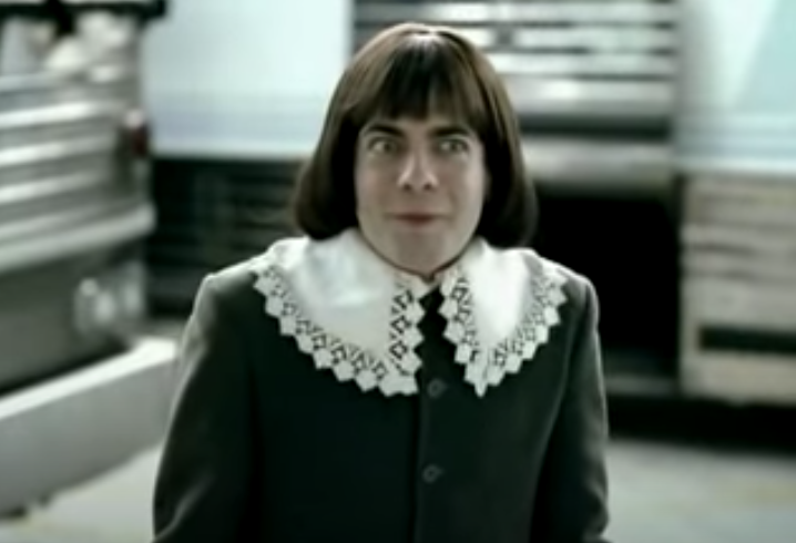A man dressed as Tom Thumb