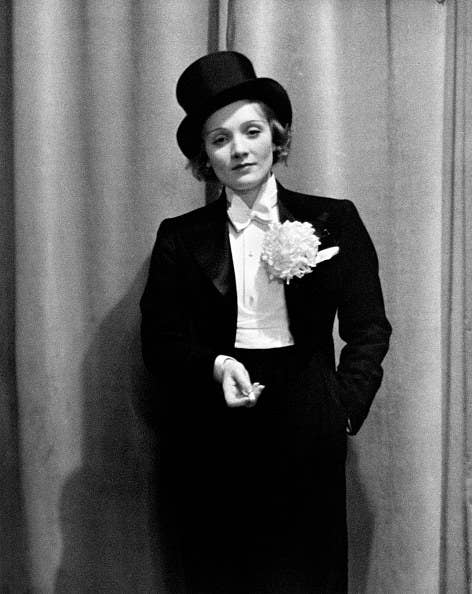 Marlene Dietrich in a suit and top hat
