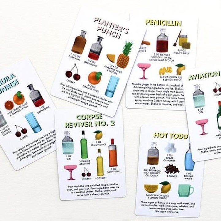 a handful of the cards with different drinks and recipes