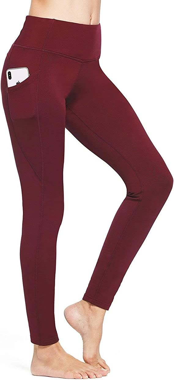A person wears a pair of tights with a pocket