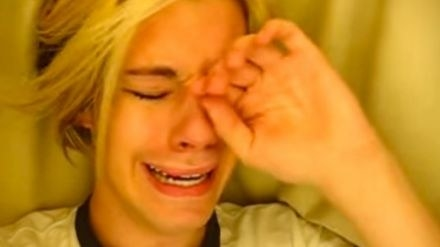 Chris Crocker under a sheet crying under a sheet