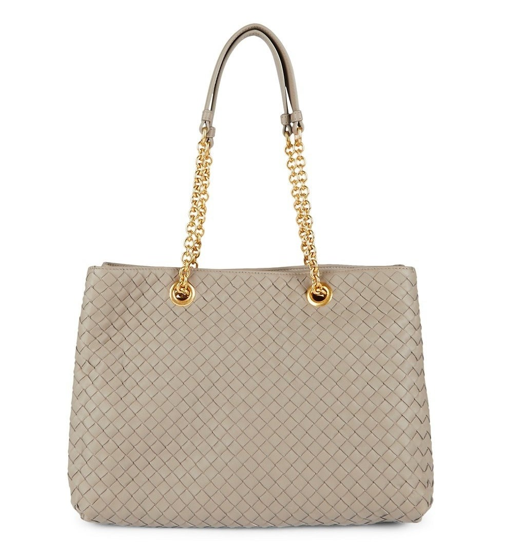 The grey tote bag with gold hardware