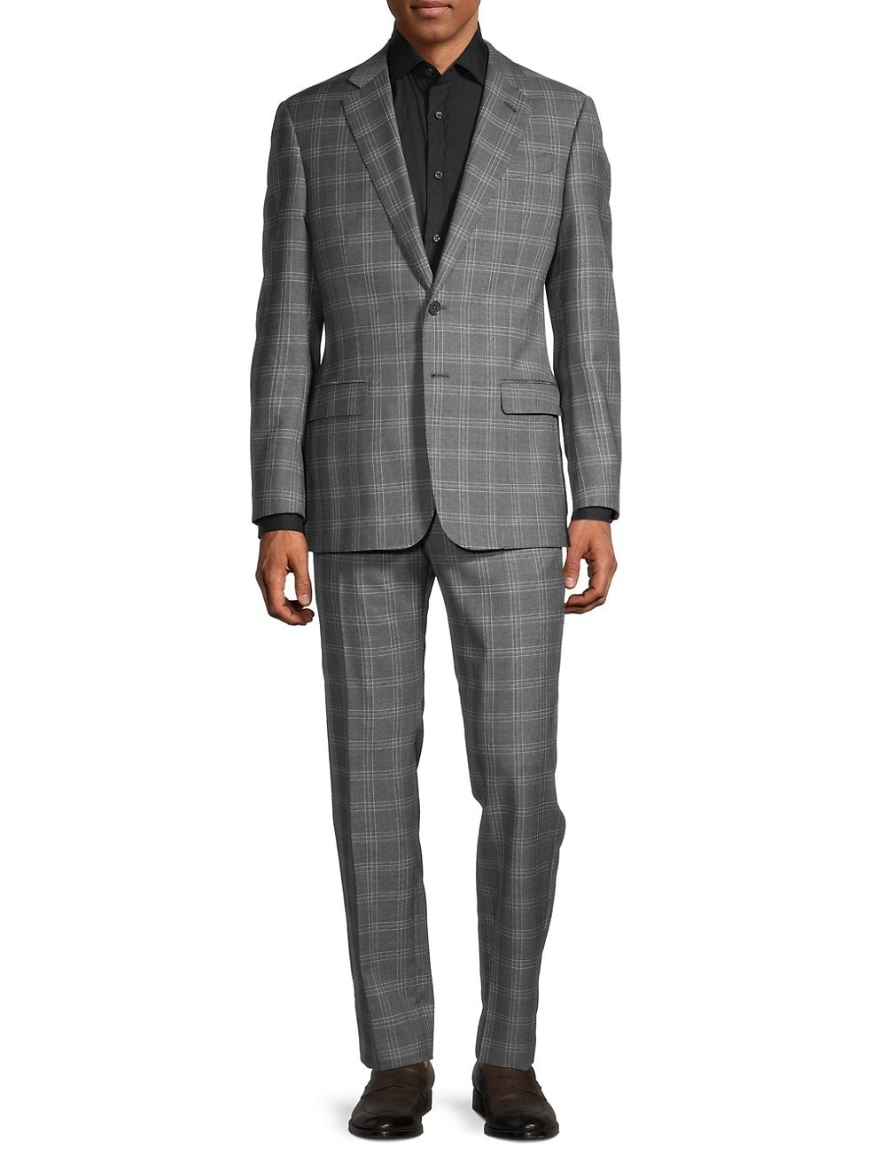 A model in the grey plaid suit