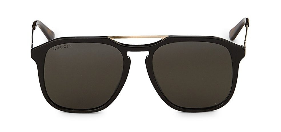The black frame sunglasses in an aviator shape with gold browbar