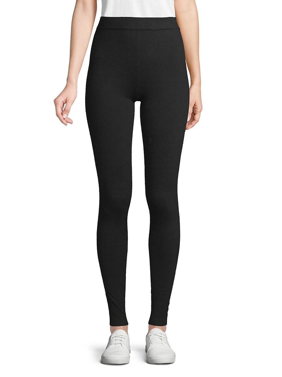Model in the black high-waisted leggings