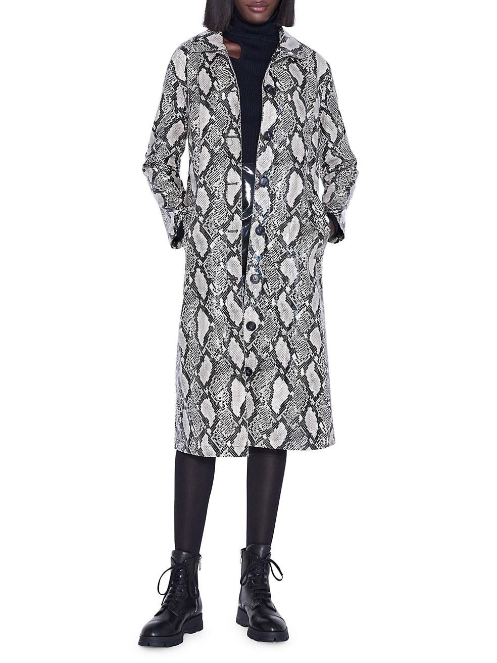 Model in the grey and white snake print knee-length coat