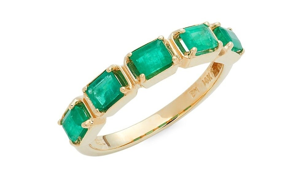 The ring with five emerald cut green stones
