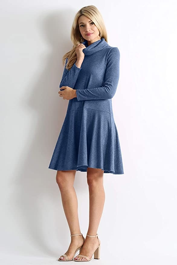 model wearing the blue dress with a turtleneck style and drop waist