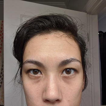 Reviewer with dark under-eye bags