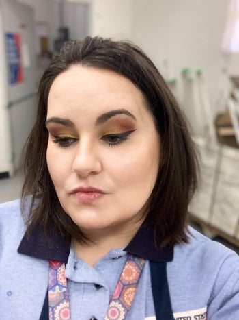 Reviewer wearing the setting spray showing their makeup does not look oily at all