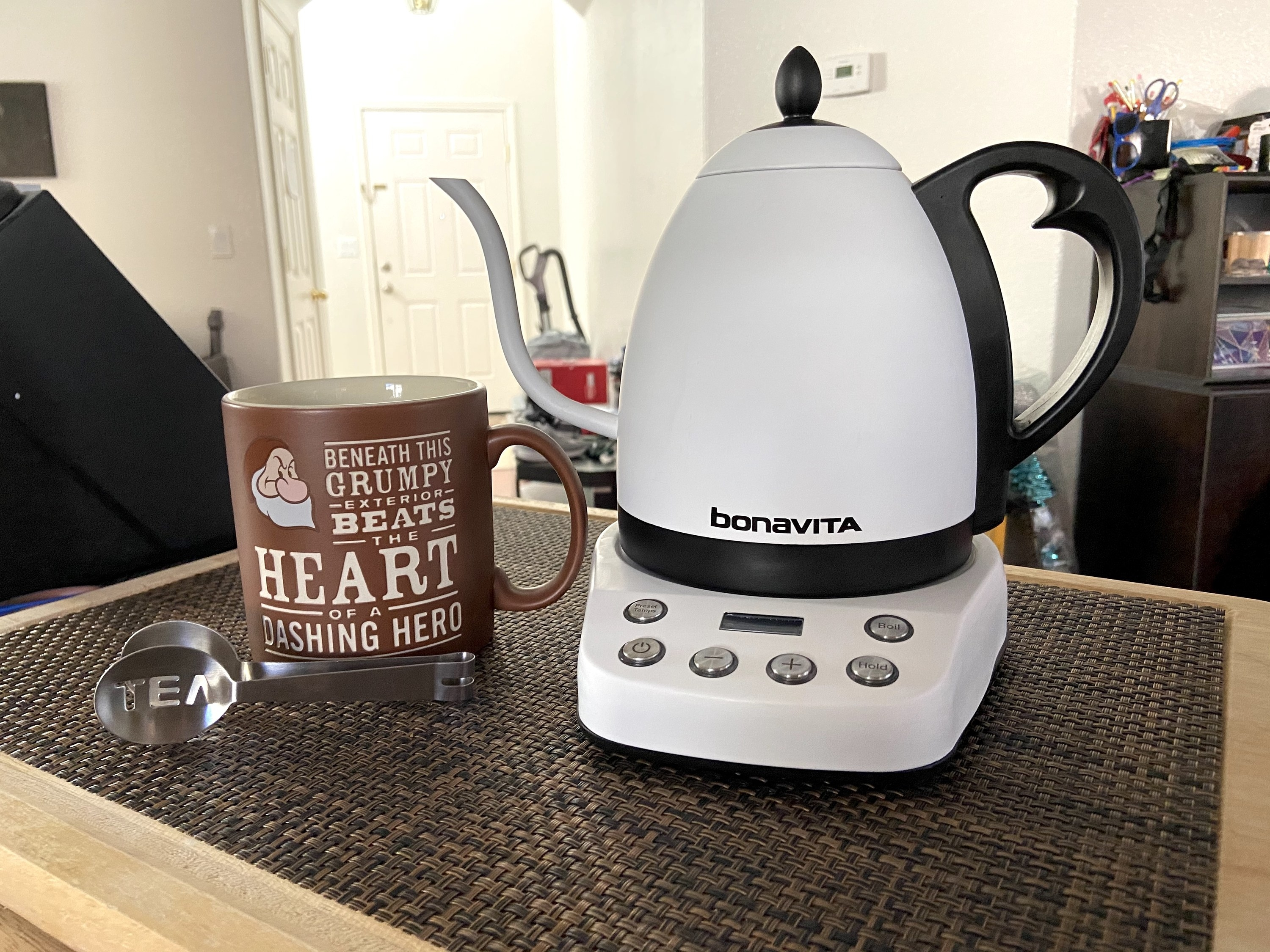 The electric kettle on a counter in white