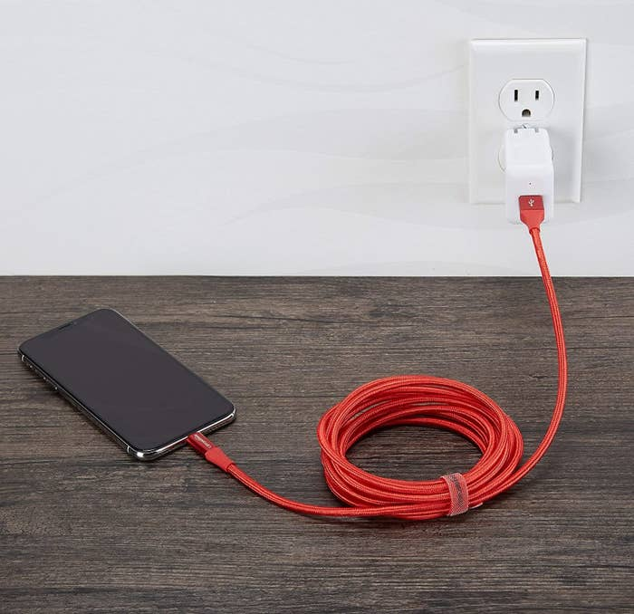 An iPhone plugged into a charger