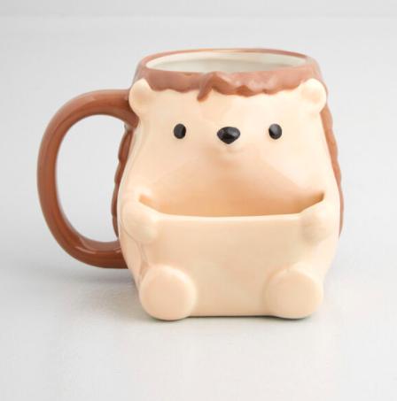 A hedgehog mug with a spot for cookies
