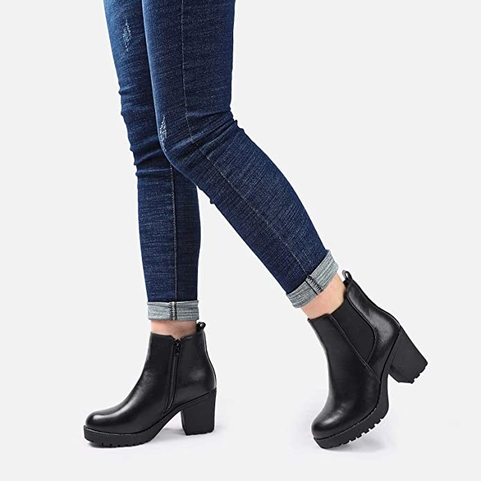 model wearing them with rolled up jeans
