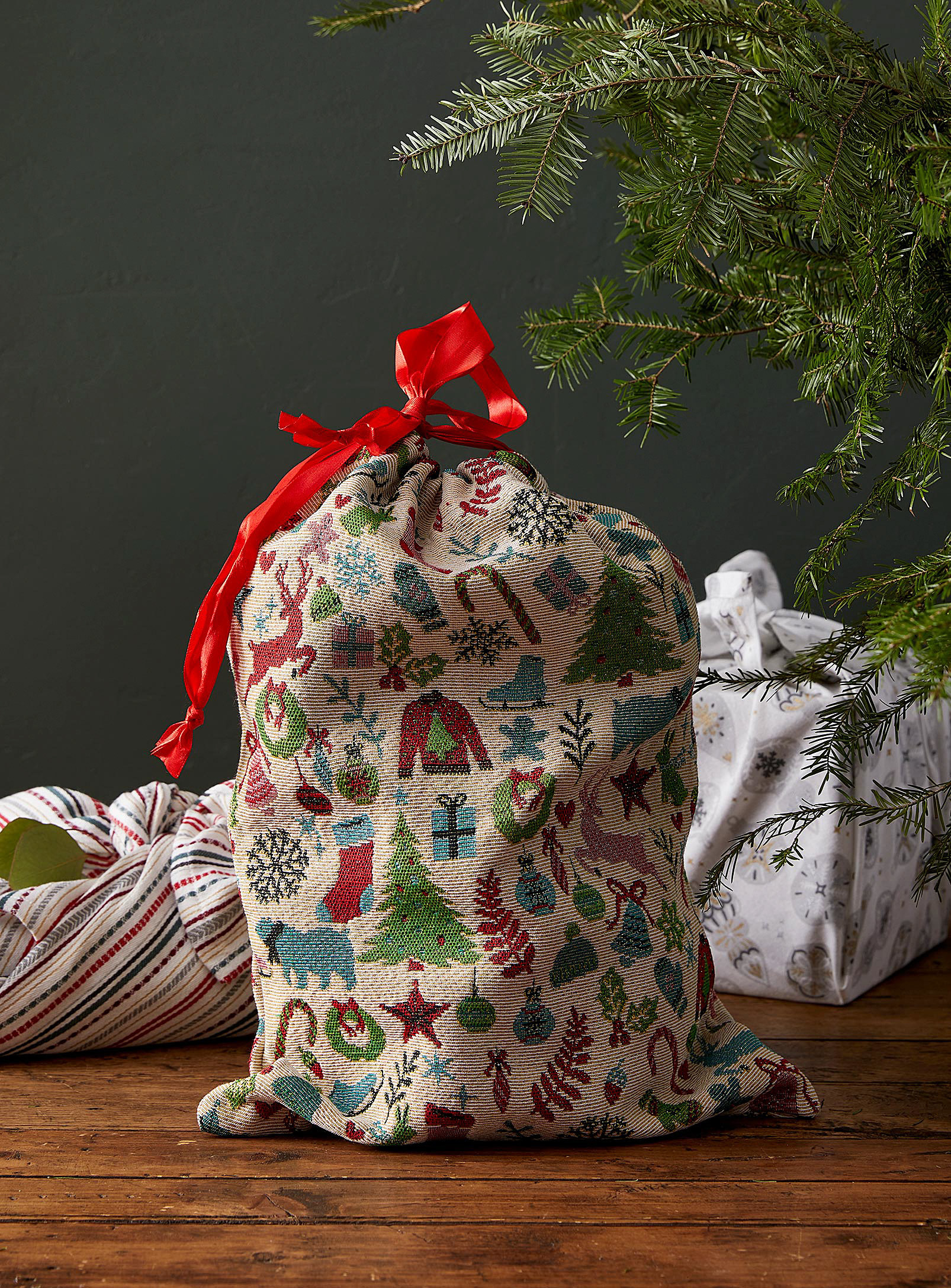 A decorative bag filled with presents