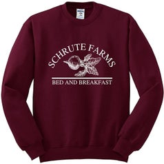maroon sweatshirt with beet that says shrute farms bed and breakfast