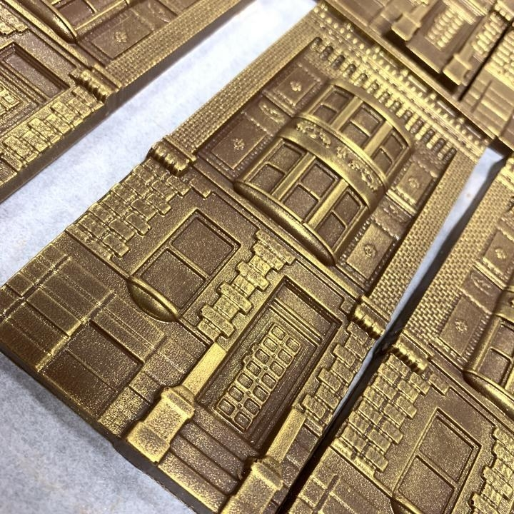 chocolate bars shaped like buildings with gold dusting