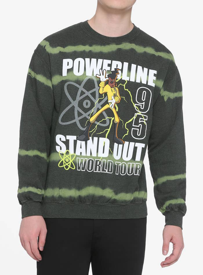 a model in a green sweatshirt with a graphic featuring powerline from a goofy movie