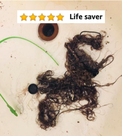 "Reviewer's picture of large pile of hair in sink next to drain snake, with five-star review caption ""lifesaver"""