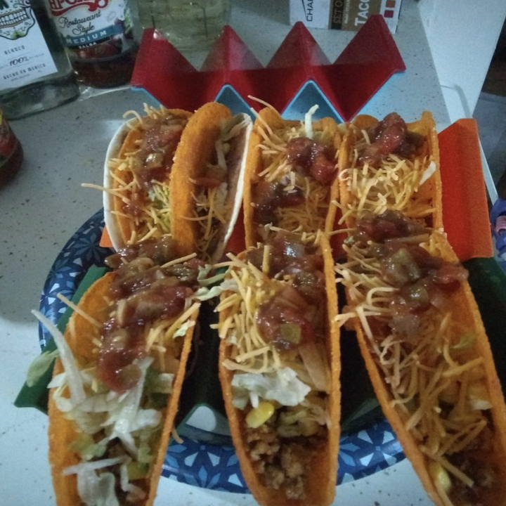 reviewer photos of tacos in the holders