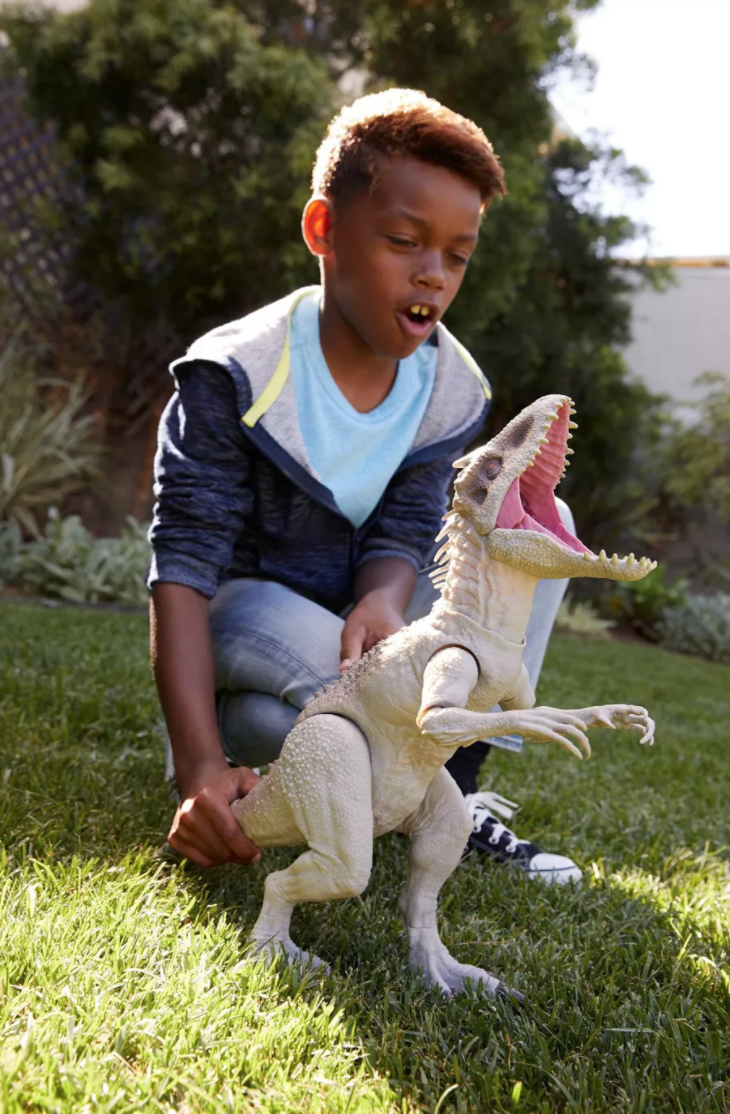 a child playing with the dinosaur toy