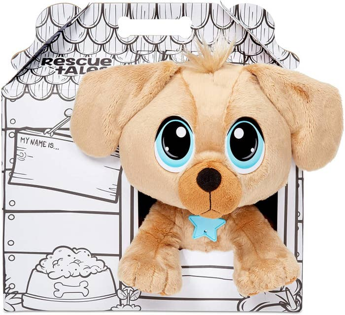 the golden retriever toy in a dog house