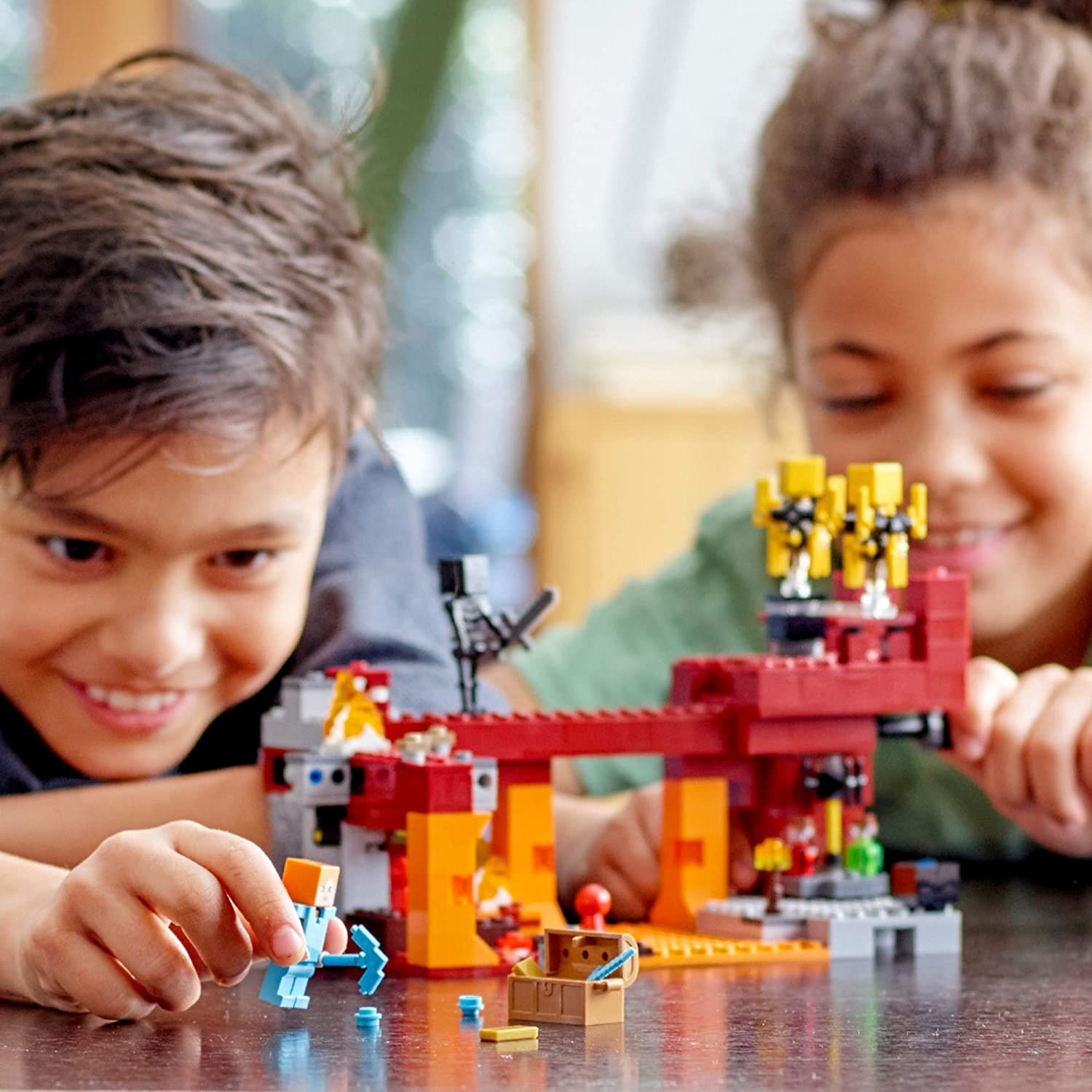 two children playing with the lego set