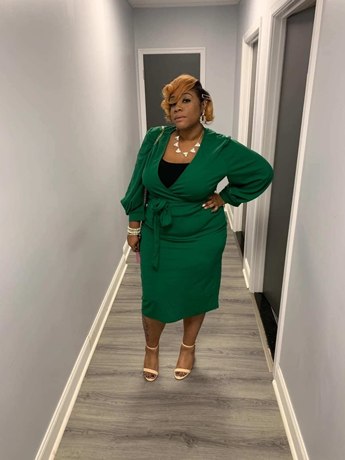 Reviewer wearing the deep v-neck wrap dress in green