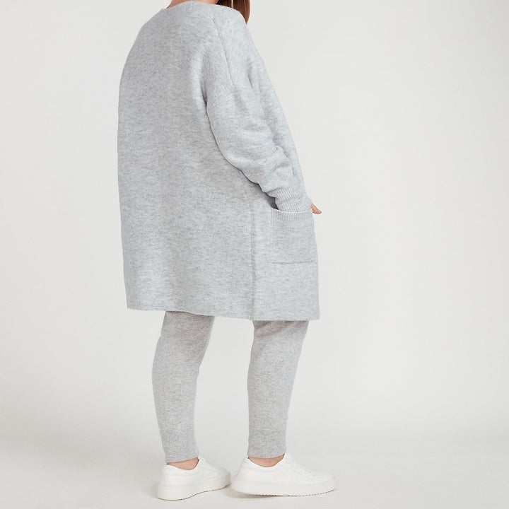model wearing the gray cardigan with pockets