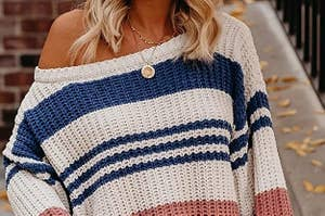 model wearing off the shoulder sweater with a stripe print a wide sleeves