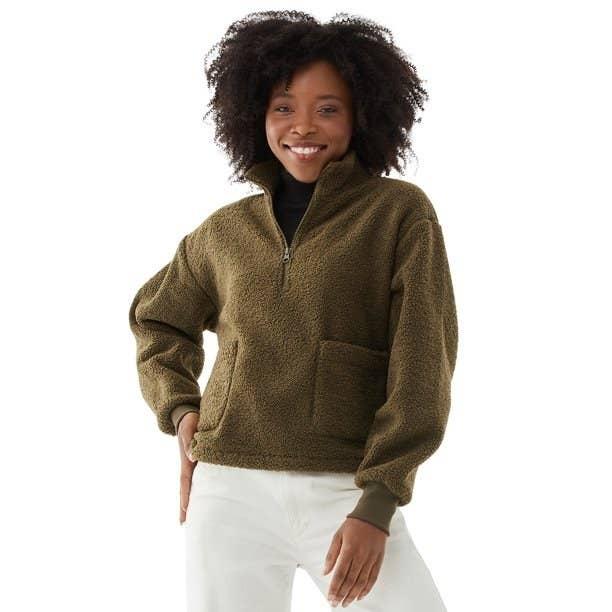 Model in half zip faux sherpa sweatshirt