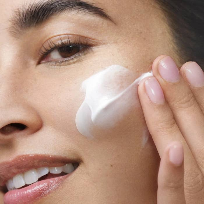 The squalane and lactic acid resurfacing night cream being applied