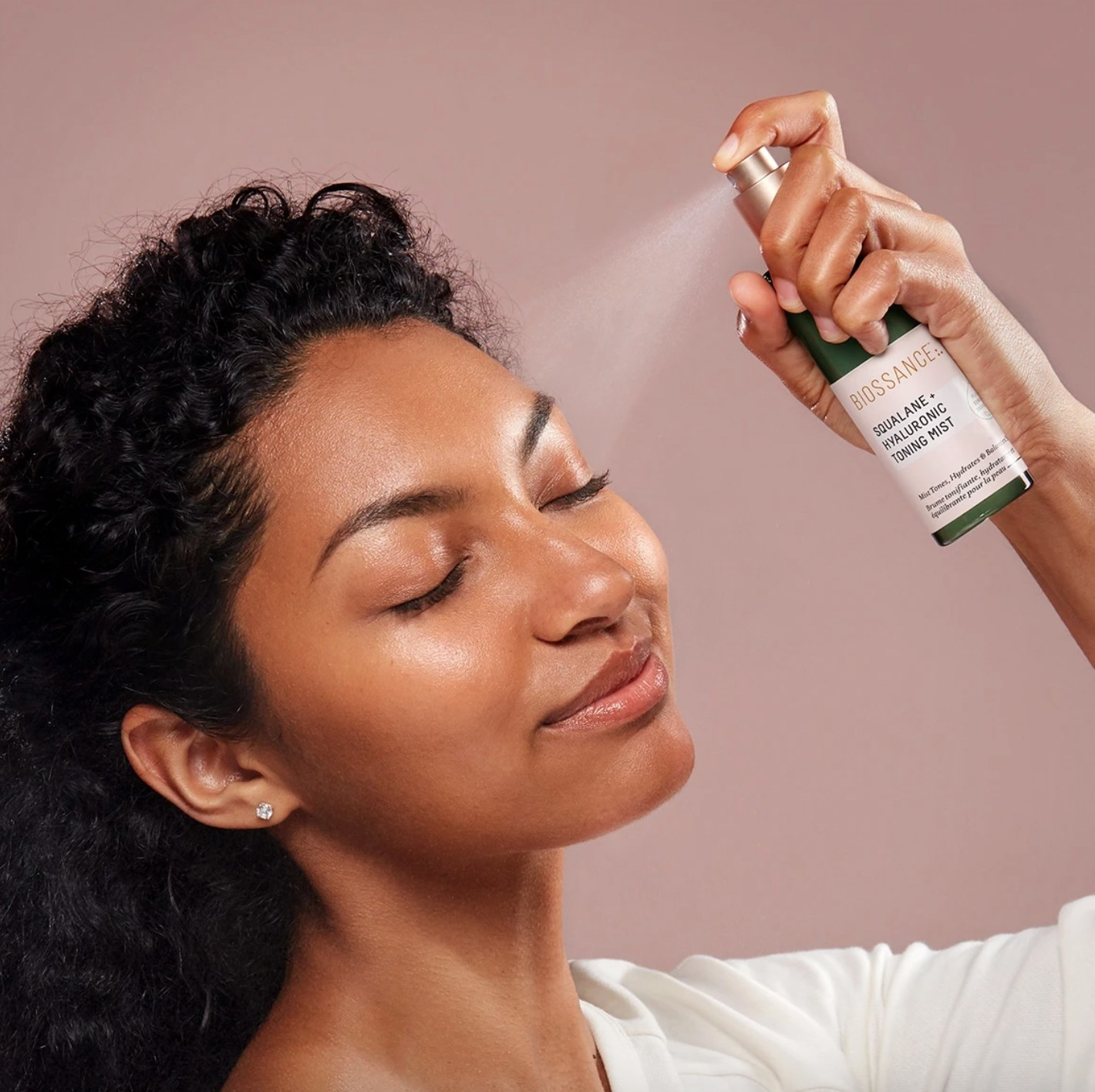 The squalane + hyaluronic toning mist in a green spray bottle