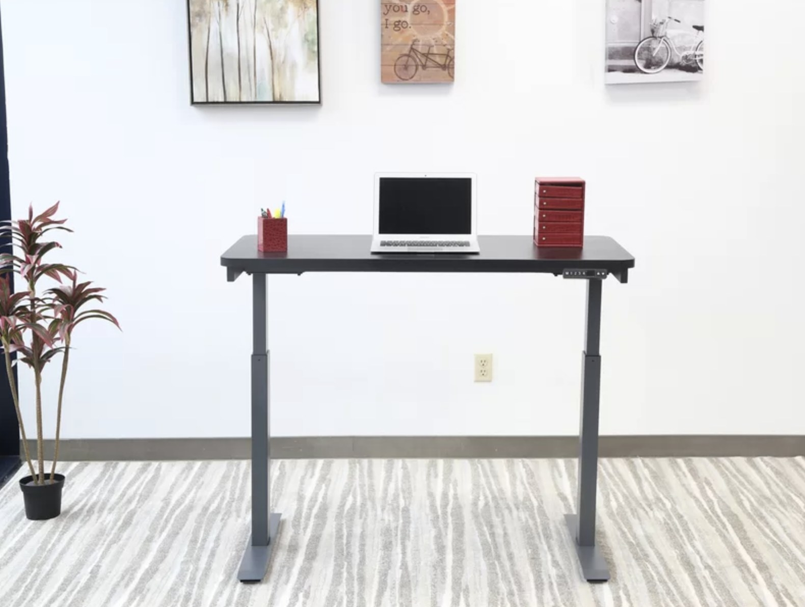 The adjustable standing desk