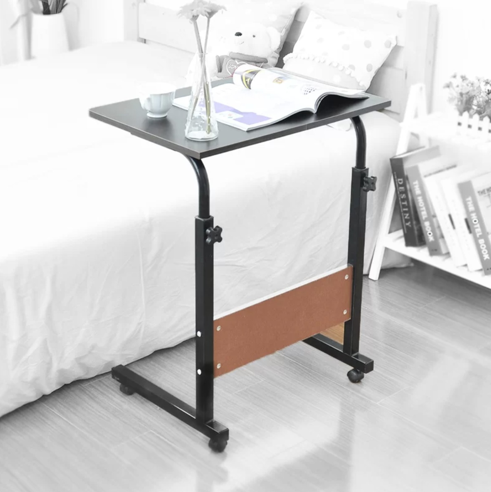 The laptop stand in a bedroom
