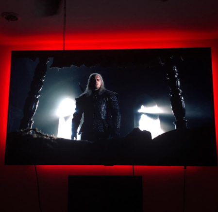 A reviewer photo of an LG OLED TV with The Witcher from Netflix on the screen