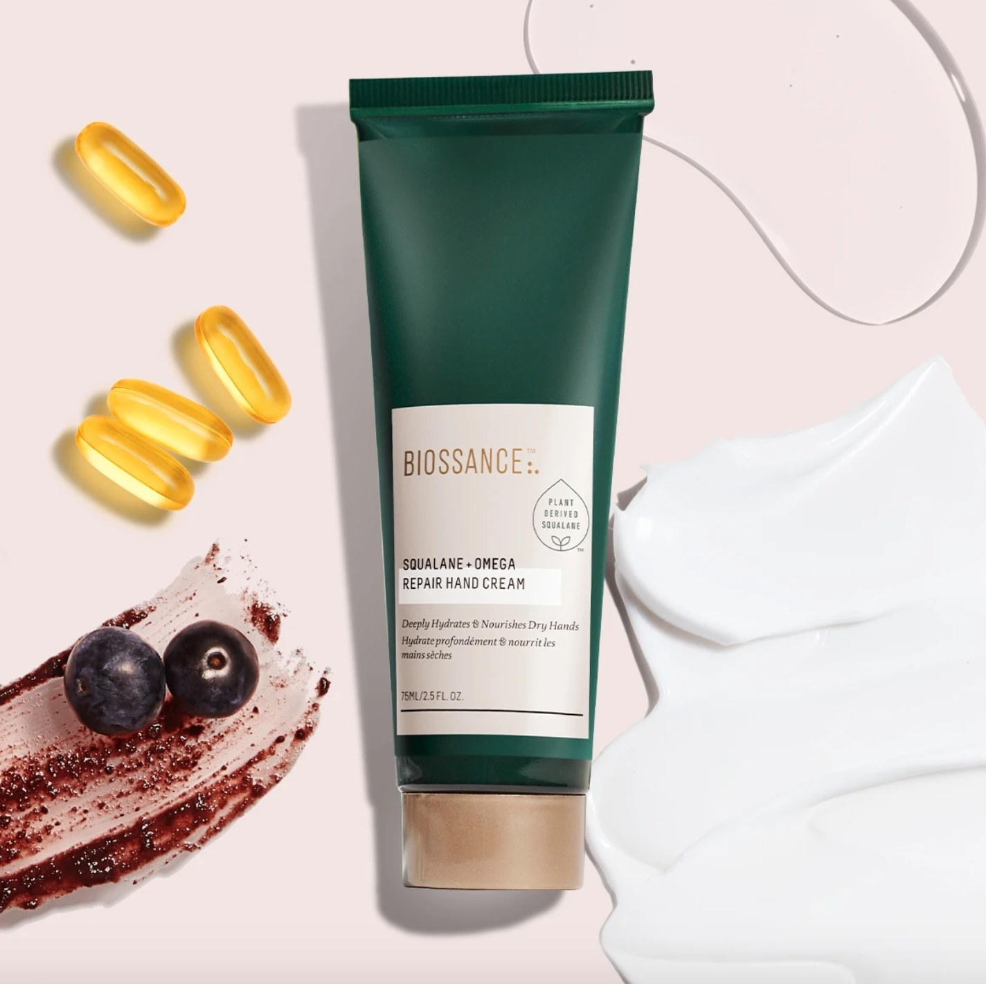 The squalane and omega repair hand cream in a green squeeze bottle