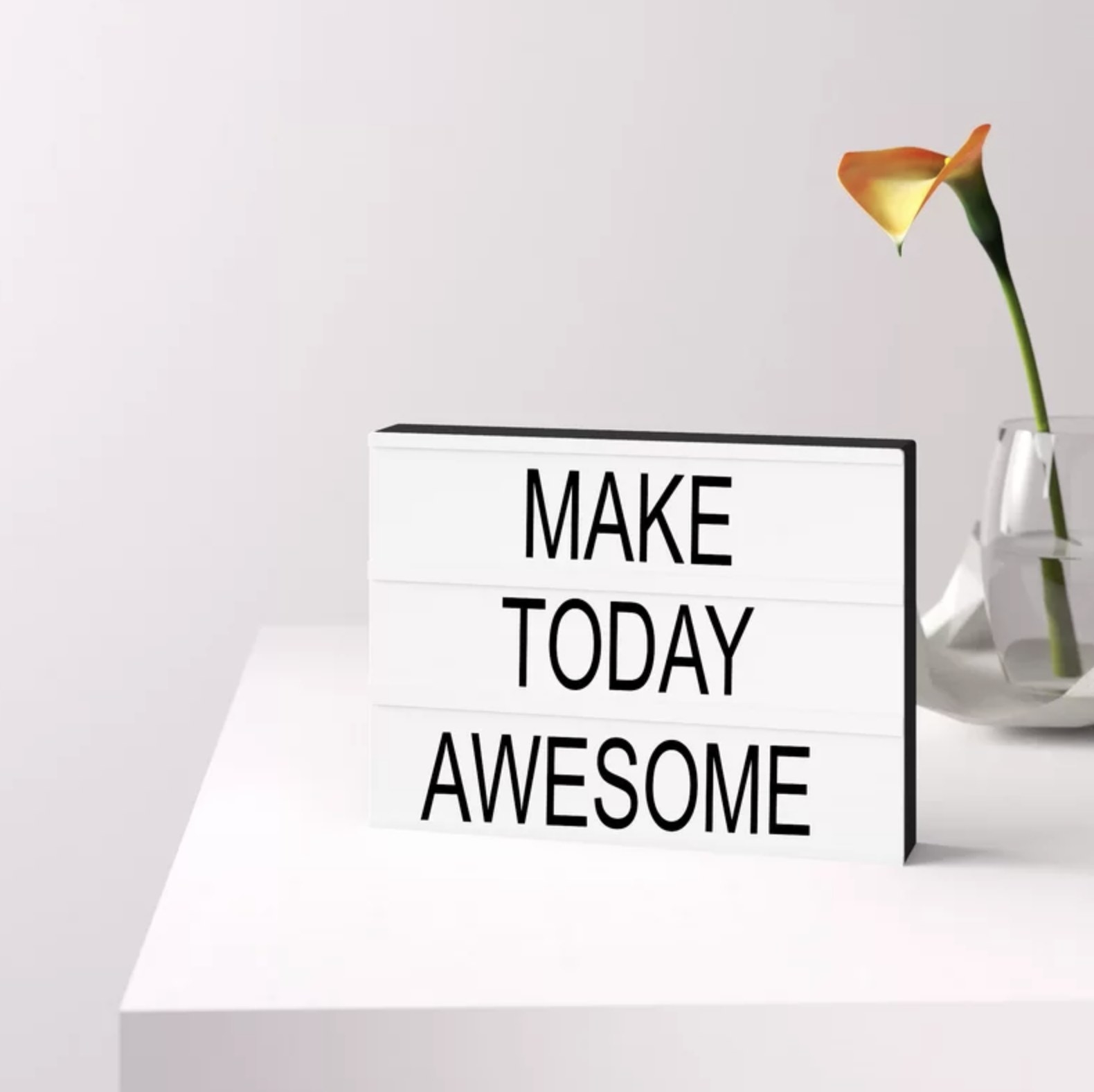 "The light box with the words ""Make today awesome"" on it"