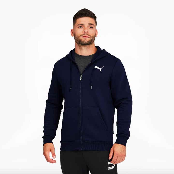 model wearing a full zip navy hoodie