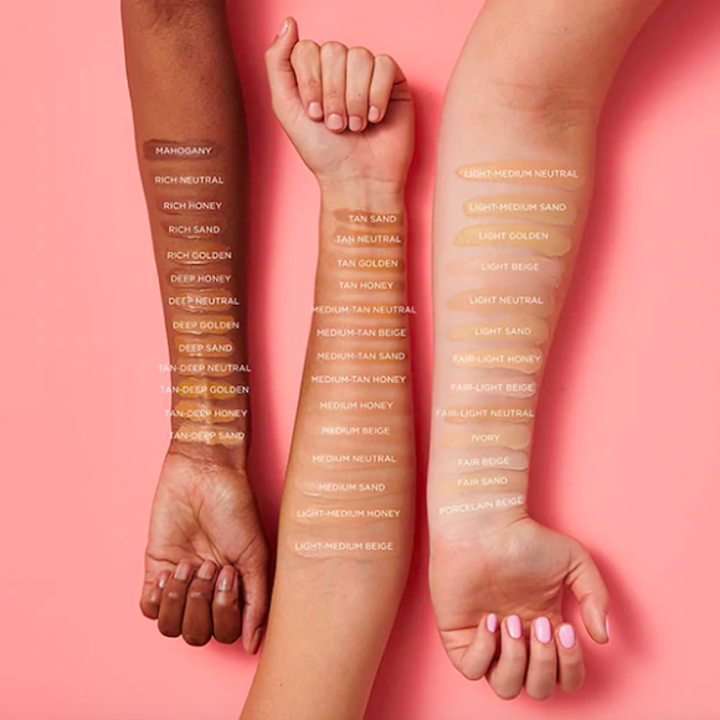 three models' forearms with varying skintones with Tarte foundation swatched