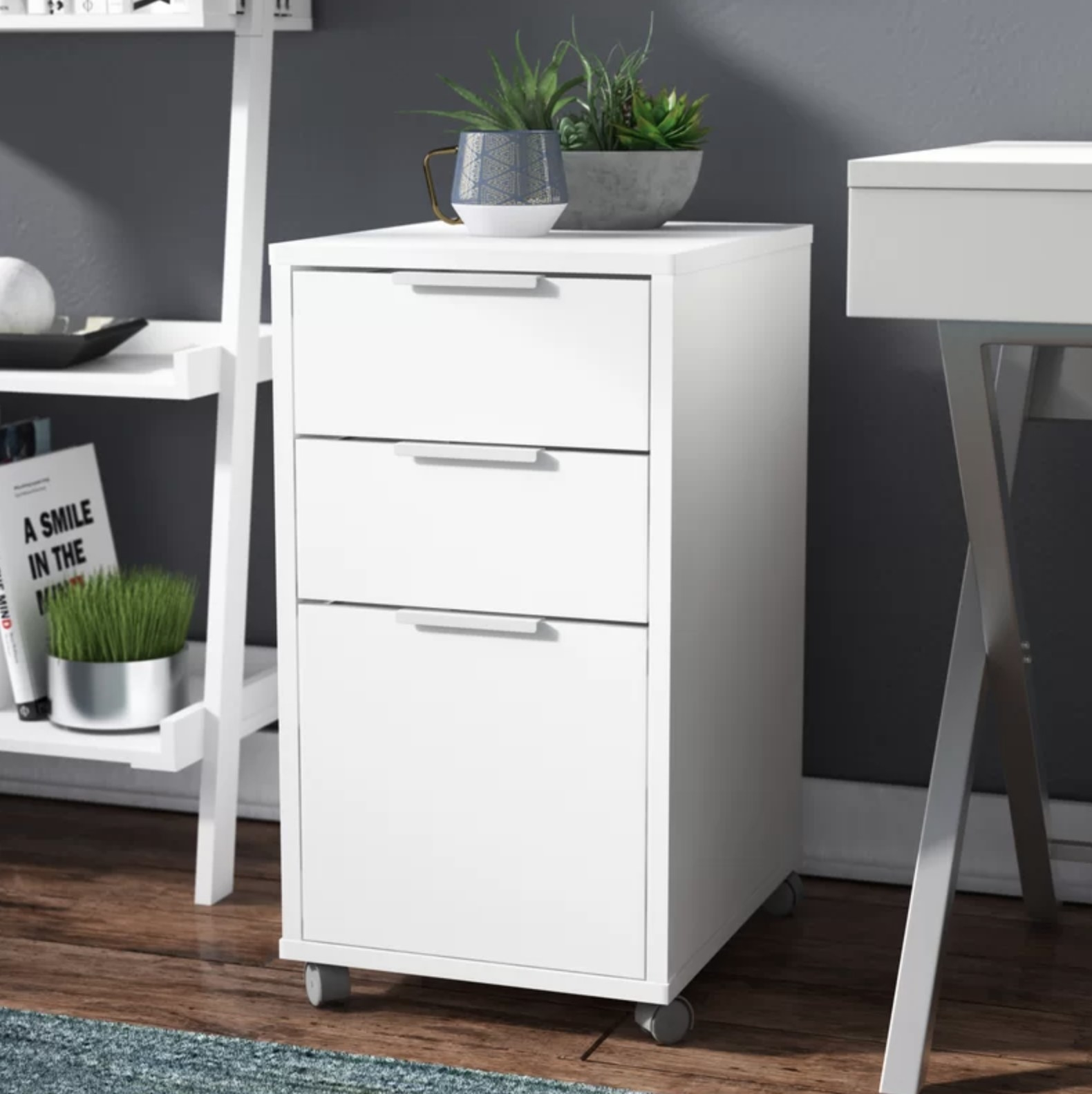 The white filing cabinet with three drawers
