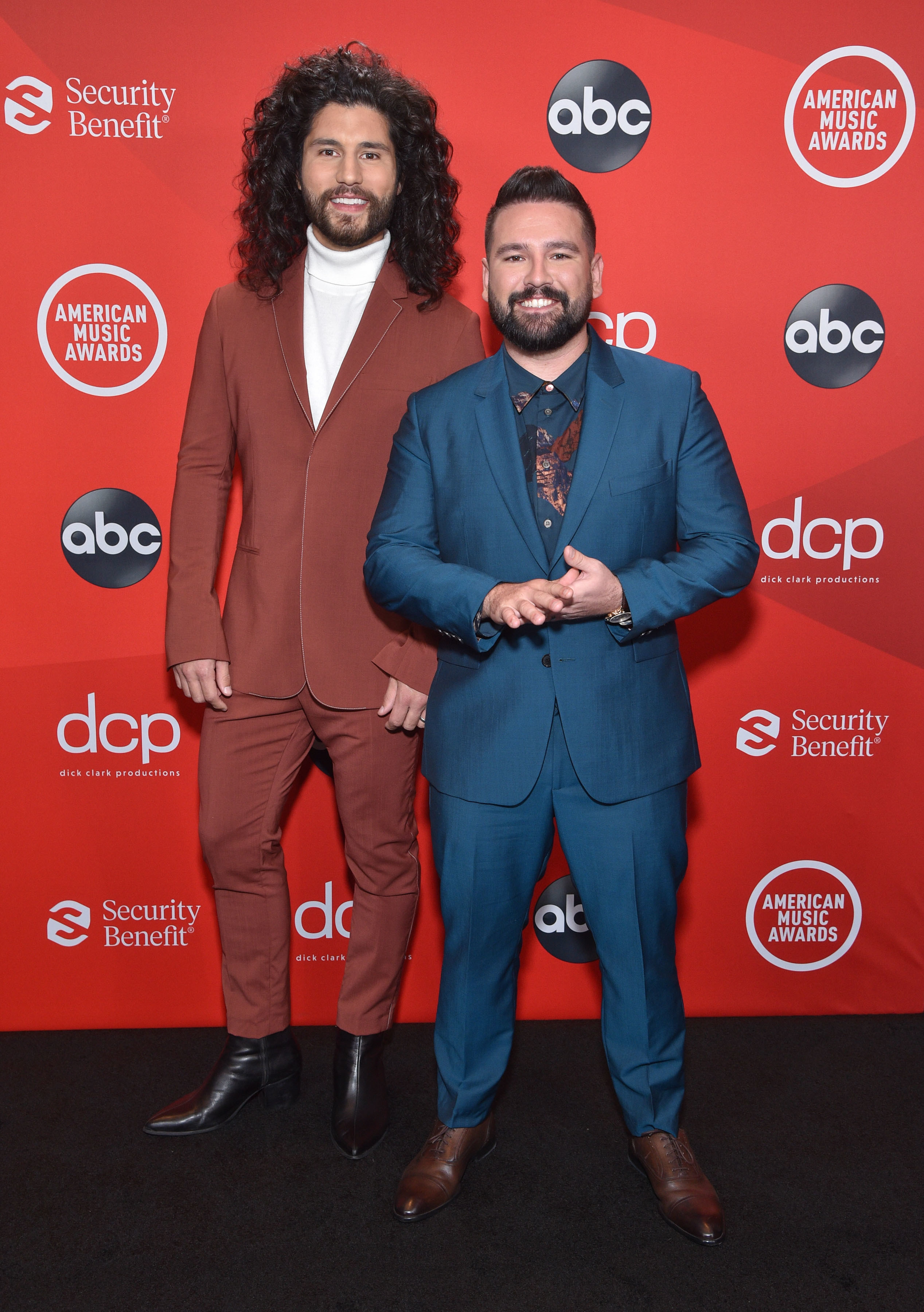 Dan Smyers and Shay Mooney of Dan + Shay wearing suits