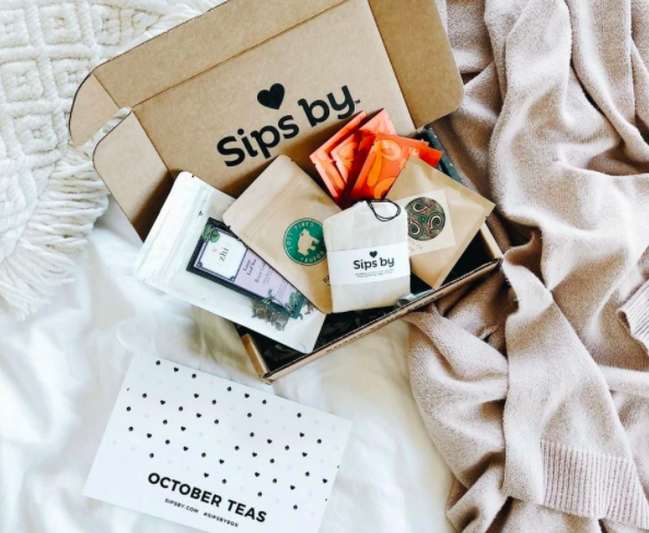 The Sips By subscription box laid out showing all the yummy tea you get