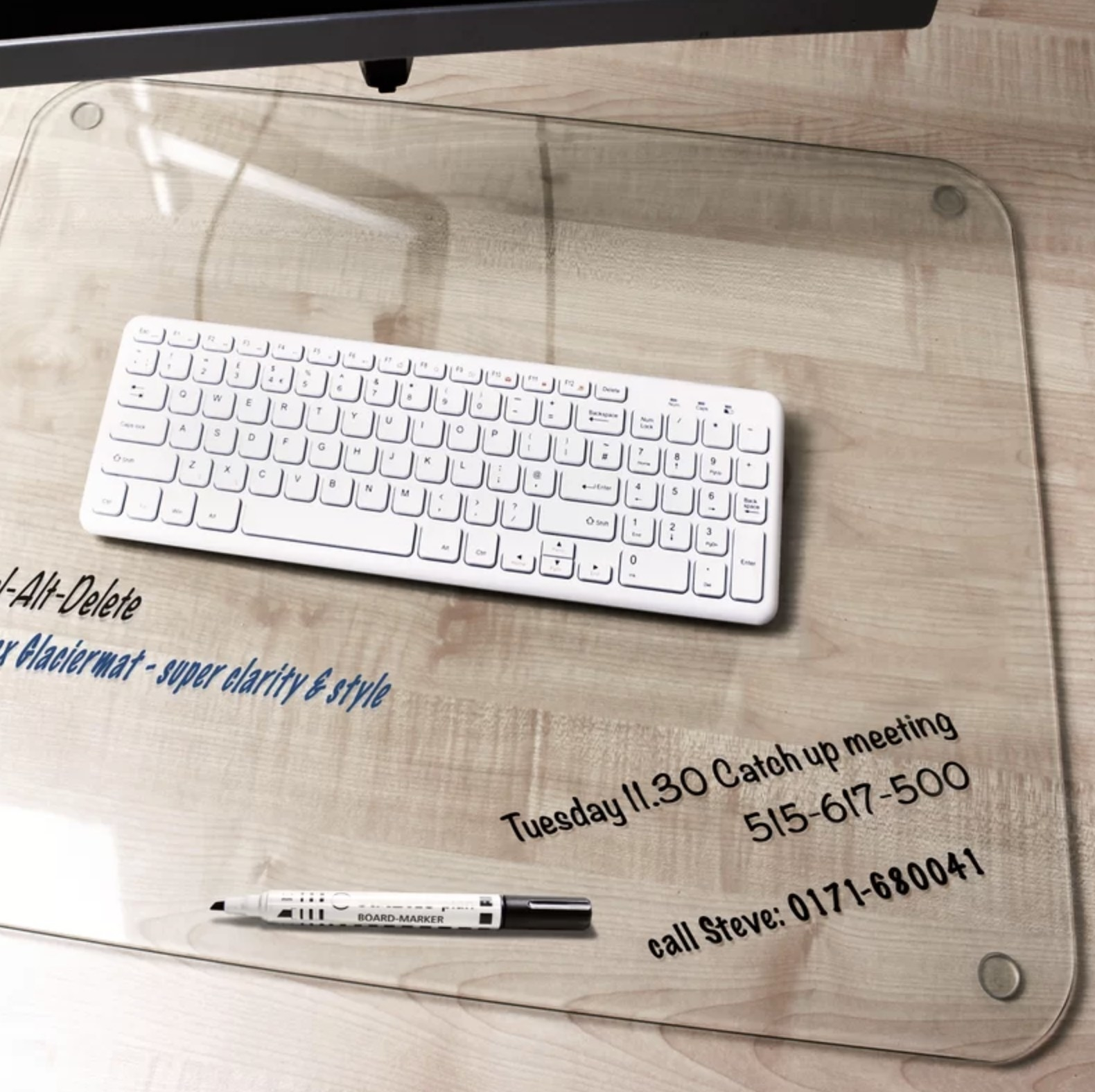 The glass desktop back with a keyboard on top