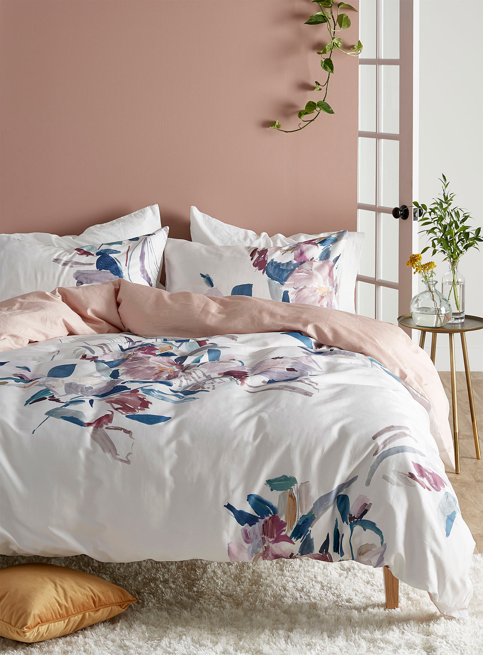 A duvet on a bed with tons of pillows